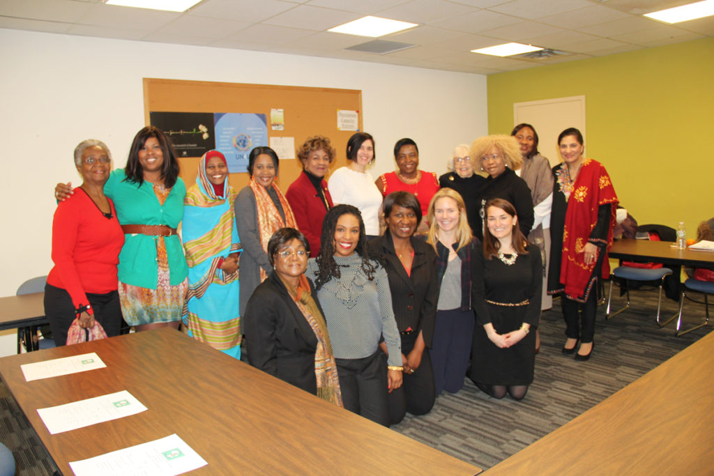 Executive Director Sarah Emond, Associate Director Claire Brown, and Fine Art Specialist Tess Standa with the United Nations African Mothers Association in New York
